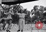 Image of Patti Thomas of Bob Hope U.S.O.troupe entertains troops  Bougainville Solomon Islands, 1944, second 2 stock footage video 65675033575