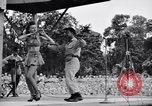 Image of Patti Thomas of Bob Hope U.S.O.troupe entertains troops  Bougainville Solomon Islands, 1944, second 4 stock footage video 65675033575