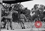 Image of Patti Thomas of Bob Hope U.S.O.troupe entertains troops  Bougainville Solomon Islands, 1944, second 10 stock footage video 65675033575