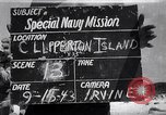 Image of men on beach Clipperton Island, 1943, second 1 stock footage video 65675033681
