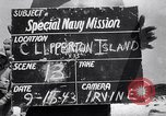 Image of men on beach Clipperton Island, 1943, second 3 stock footage video 65675033681