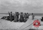 Image of men on beach Clipperton Island, 1943, second 10 stock footage video 65675033681