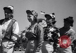 Image of girl jockeys Mexico, 1939, second 8 stock footage video 65675033936