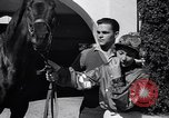 Image of girl jockeys Mexico, 1939, second 12 stock footage video 65675033936