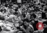 Image of boxer Jack Dempsey giving food to orphans Long Beach New York USA, 1936, second 3 stock footage video 65675034182