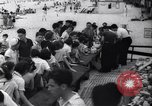 Image of boxer Jack Dempsey giving food to orphans Long Beach New York USA, 1936, second 4 stock footage video 65675034182