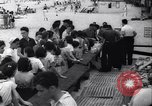 Image of boxer Jack Dempsey giving food to orphans Long Beach New York USA, 1936, second 5 stock footage video 65675034182