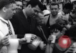 Image of boxer Jack Dempsey giving food to orphans Long Beach New York USA, 1936, second 6 stock footage video 65675034182