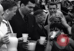 Image of boxer Jack Dempsey giving food to orphans Long Beach New York USA, 1936, second 7 stock footage video 65675034182