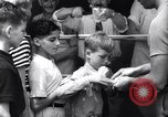 Image of boxer Jack Dempsey giving food to orphans Long Beach New York USA, 1936, second 8 stock footage video 65675034182