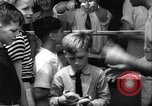Image of boxer Jack Dempsey giving food to orphans Long Beach New York USA, 1936, second 9 stock footage video 65675034182
