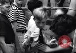 Image of boxer Jack Dempsey giving food to orphans Long Beach New York USA, 1936, second 10 stock footage video 65675034182