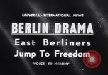 Image of East Berlin people escape over Berlin Wall Germany, 1961, second 1 stock footage video 65675034204