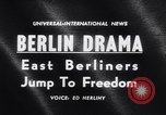 Image of East Berlin people escape over Berlin Wall Germany, 1961, second 2 stock footage video 65675034204