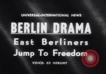 Image of East Berlin people escape over Berlin Wall Germany, 1961, second 4 stock footage video 65675034204