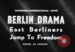 Image of East Berlin people escape over Berlin Wall Germany, 1961, second 5 stock footage video 65675034204