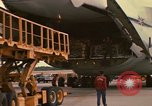 Image of C-5A being offloaded by airmen of 6th Aerial Port Squadron Thailand, 1972, second 12 stock footage video 65675034383
