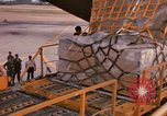Image of US 6th Aerial Port Squadron personnel offloading a C-5 aircraft Thailand, 1972, second 11 stock footage video 65675034384