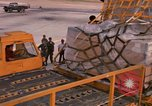 Image of US 6th Aerial Port Squadron personnel offloading a C-5 aircraft Thailand, 1972, second 12 stock footage video 65675034384