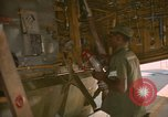 Image of refueling hose connected to centerpoint refueling valve U-Tapao Royal Thai Air Force Base Thailand, 1969, second 12 stock footage video 65675034397
