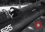 Image of Marine Aircraft Group 11 F4U Corsairs arrive back from mission Espiritu Santo New Hebrides Islands, 1944, second 2 stock footage video 65675034617
