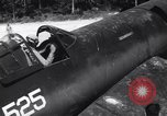 Image of Marine Aircraft Group 11 F4U Corsairs arrive back from mission Espiritu Santo New Hebrides Islands, 1944, second 4 stock footage video 65675034617