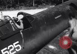 Image of Marine Aircraft Group 11 F4U Corsairs arrive back from mission Espiritu Santo New Hebrides Islands, 1944, second 5 stock footage video 65675034617