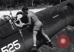 Image of Marine Aircraft Group 11 F4U Corsairs arrive back from mission Espiritu Santo New Hebrides Islands, 1944, second 9 stock footage video 65675034617