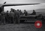 Image of B-26 bomber aircraft being armed Tunisia North Africa, 1943, second 5 stock footage video 65675034693