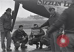 Image of Officers of 334th USAAF Fighter Squadron talk with ground crews Debden England, 1945, second 1 stock footage video 65675034697