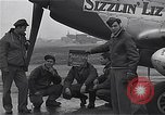 Image of Officers of 334th USAAF Fighter Squadron talk with ground crews Debden England, 1945, second 2 stock footage video 65675034697