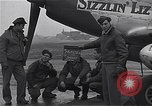 Image of Officers of 334th USAAF Fighter Squadron talk with ground crews Debden England, 1945, second 3 stock footage video 65675034697