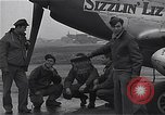 Image of Officers of 334th USAAF Fighter Squadron talk with ground crews Debden England, 1945, second 4 stock footage video 65675034697