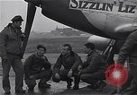 Image of Officers of 334th USAAF Fighter Squadron talk with ground crews Debden England, 1945, second 5 stock footage video 65675034697