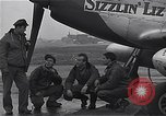 Image of Officers of 334th USAAF Fighter Squadron talk with ground crews Debden England, 1945, second 6 stock footage video 65675034697