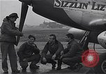 Image of Officers of 334th USAAF Fighter Squadron talk with ground crews Debden England, 1945, second 8 stock footage video 65675034697