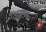 Image of Officers of 334th USAAF Fighter Squadron talk with ground crews Debden England, 1945, second 9 stock footage video 65675034697