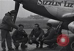 Image of Officers of 334th USAAF Fighter Squadron talk with ground crews Debden England, 1945, second 10 stock footage video 65675034697