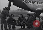 Image of Officers of 334th USAAF Fighter Squadron talk with ground crews Debden England, 1945, second 11 stock footage video 65675034697