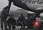 Image of Officers of 334th USAAF Fighter Squadron talk with ground crews Debden England, 1945, second 12 stock footage video 65675034697