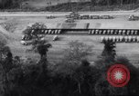 Image of trucks parked Ledo Road Tingkawk Burma, 1945, second 4 stock footage video 65675034822