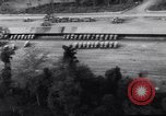 Image of trucks parked Ledo Road Tingkawk Burma, 1945, second 5 stock footage video 65675034822