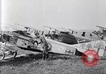 Image of U.S. fliers inspect airplanes on Air Memorial Day Hollywood California USA, 1919, second 12 stock footage video 65675034839