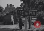 Image of American 3rd Armored Division entering towns in World War II France, 1944, second 2 stock footage video 65675034882