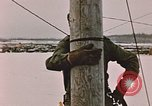 Image of linesman Elmendorf Air Force Base Alaska USA, 1954, second 10 stock footage video 65675034965
