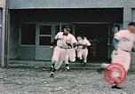 Image of baseball players Fort Richardson Alaska USA, 1954, second 11 stock footage video 65675034977