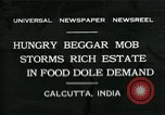 Image of beggars Calcutta India, 1931, second 1 stock footage video 65675035120