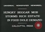 Image of beggars Calcutta India, 1931, second 3 stock footage video 65675035120