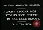 Image of beggars Calcutta India, 1931, second 10 stock footage video 65675035120
