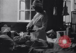Image of Nurse tending to wounded American soldiers in  World War 1 United States USA, 1918, second 6 stock footage video 65675035179
